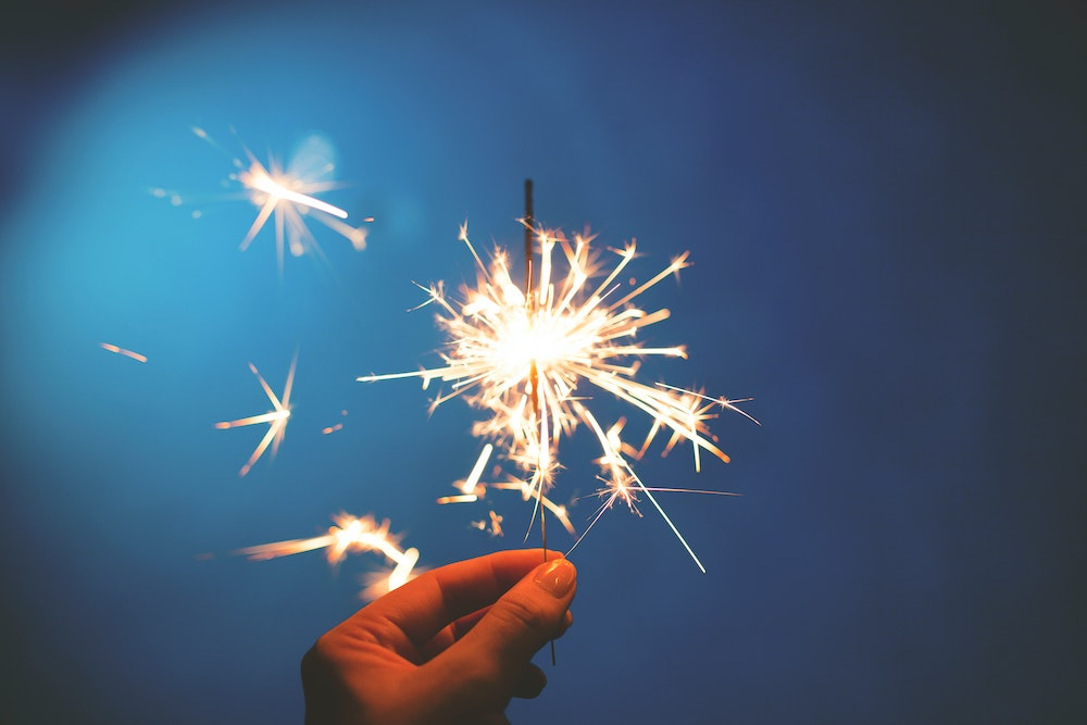 summer fire safety - person holding a sparkler